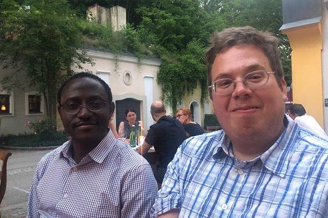 Justine Olawande Daramola und Thomas Moser