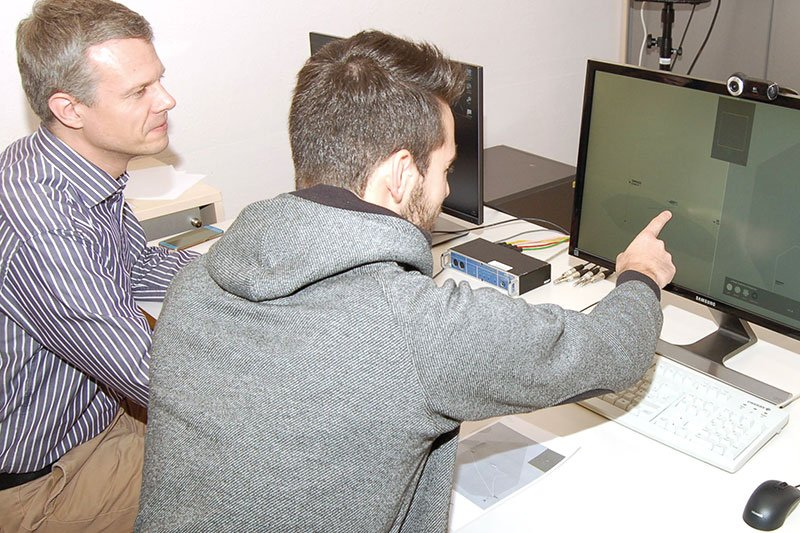 Two researchers testing the new air traffic control procedure